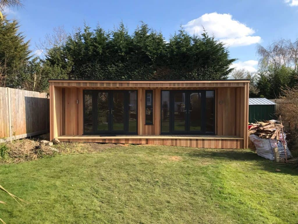 Large garden room with 2 sets of doors and window in the middle