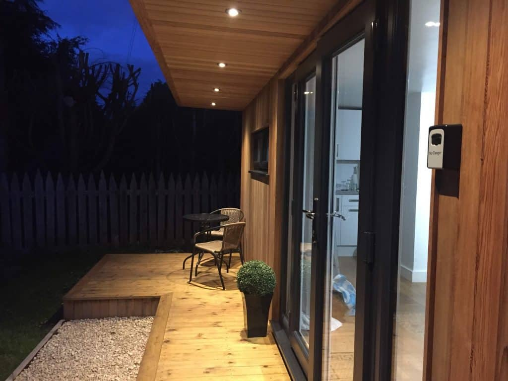 Garden room with lights on in the evening