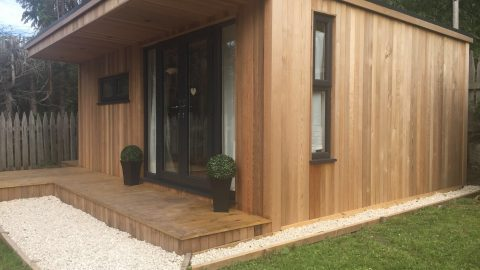 Garden room with storage. Side view in recently landscaped garden