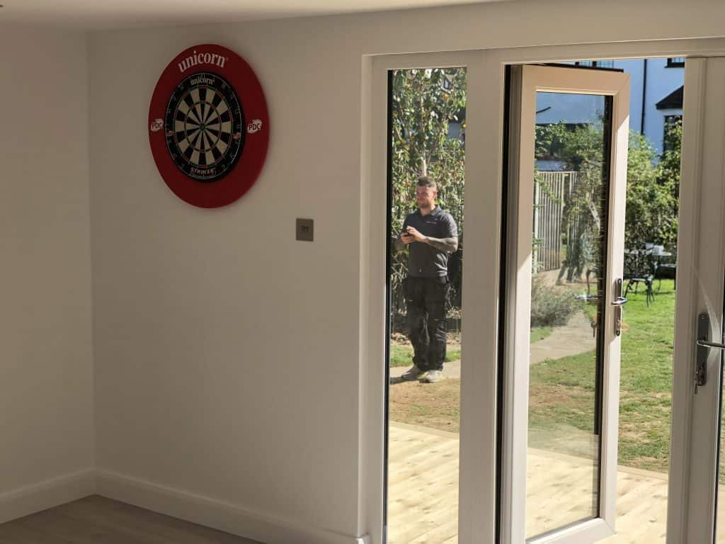 Interior of garden room with dart board