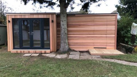 Bespoke 'L' shaped cedar clad garden room, with intergrated shed and a hidden cedar door