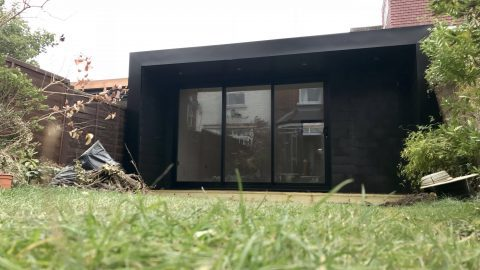 Composite garden room, with sliding patio doors and hidden shed