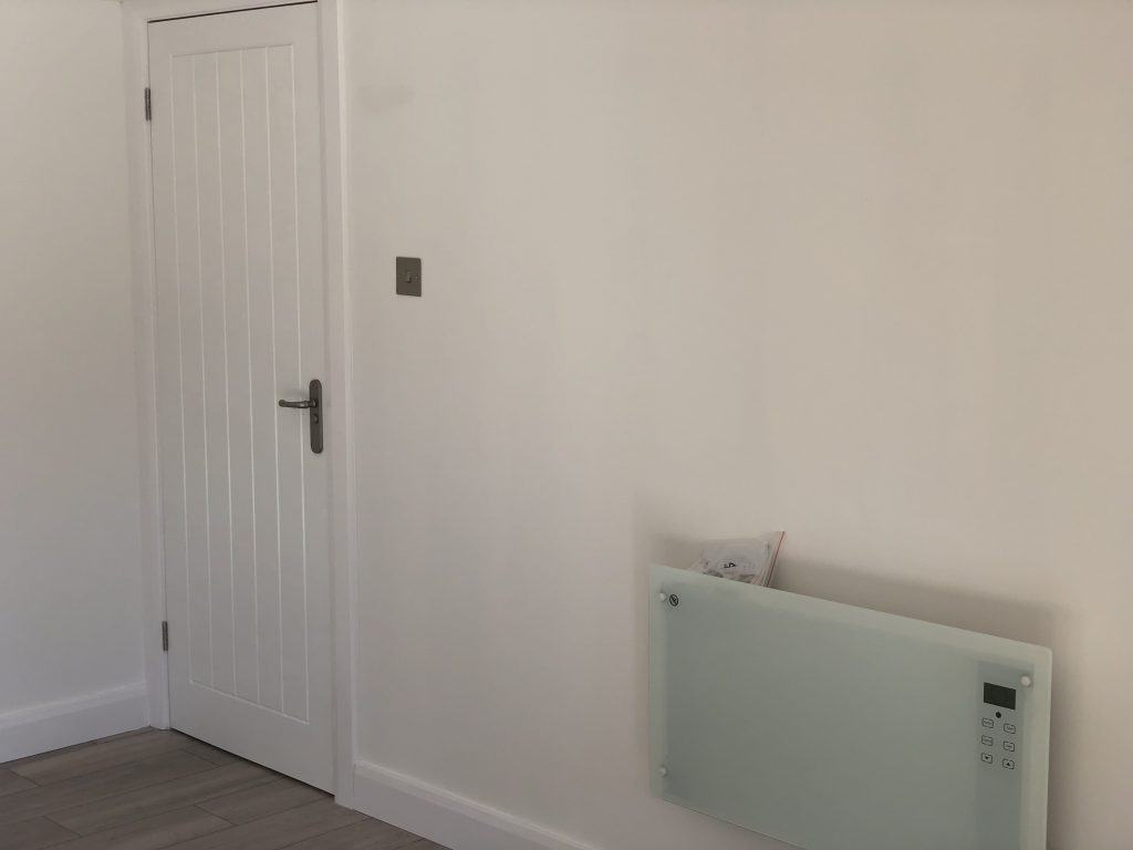 Modern internal door and electric wall mounted heater from laptronic