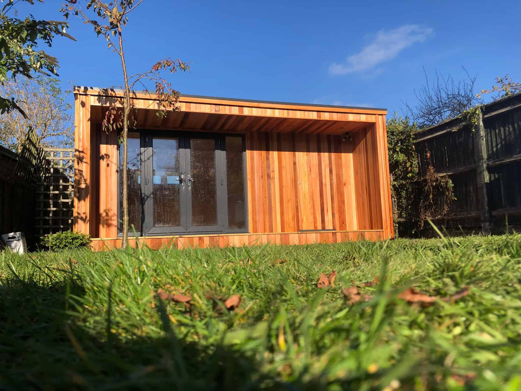 Concave Garden Office with a secret shed door
