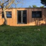 Cedar clad man cave, sat at the bottom of a garden. 1.5m french doors are fit central on the building with two windows sat either side keeping the building looking symmetrical and stylish.