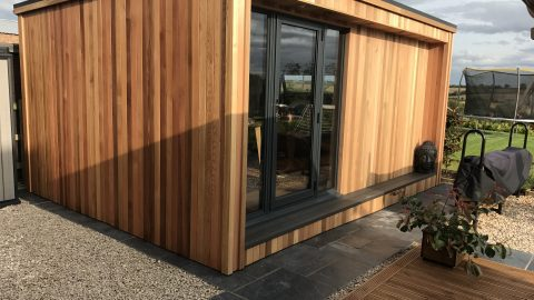 5m x 3m cedar clad home office, with anthracite aluminium door.