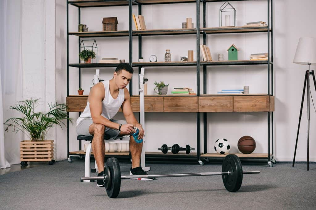 Man working out in his own home gym