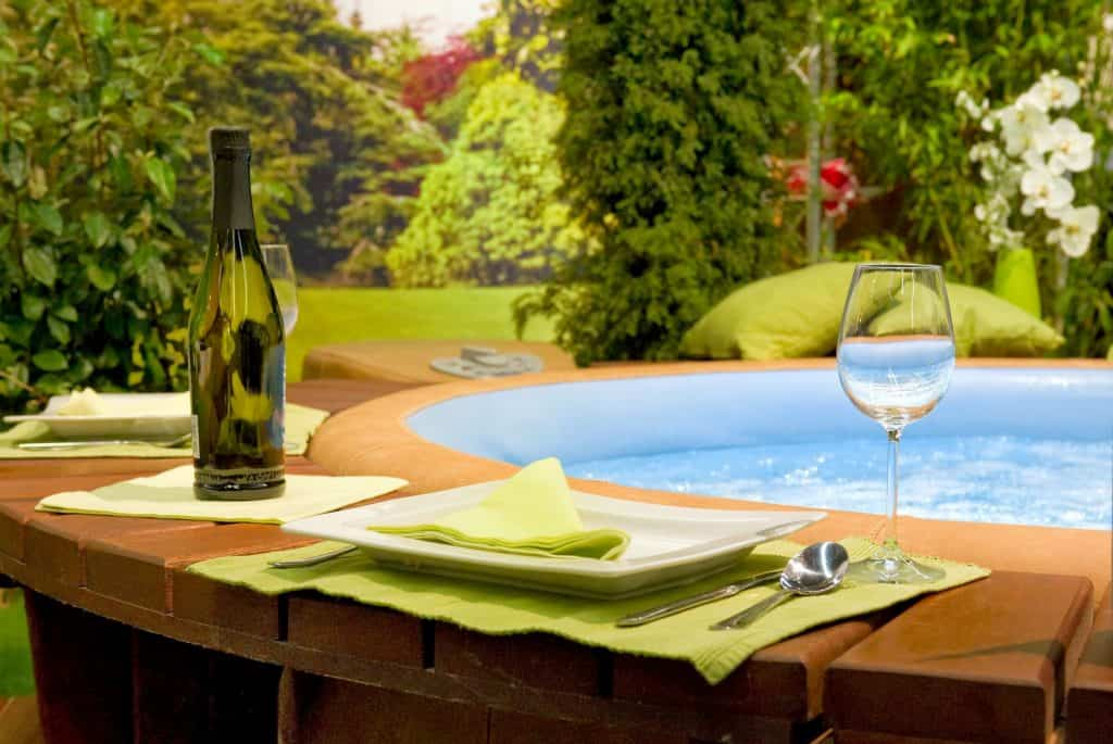 A modern garden with a hot tub and wine!