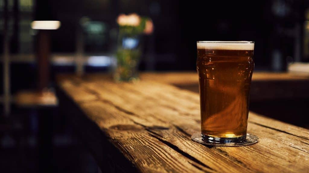 beer in a wooden garden bar