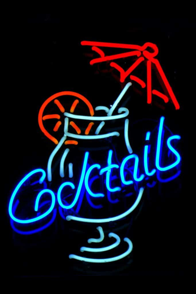 cocktail sign in small garden bar